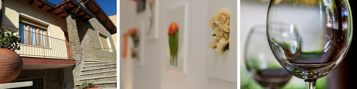 Scegliere la casa vacanze giusta per il tuo soggiorno nel Chianti - banner immagini ingresso della casa-quadri con fiori-calici di vino